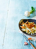 Fried chicken breast on white turnips with lovage (Paleo)