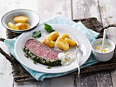 Slow-roasted beef with a herb topping and moringa powder