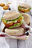 Vegan sandwiches with vegetable nuggets, hummus and tomatoes