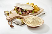 A doner kebab on a chopping board