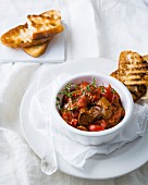 Spicy chicken liver with peri-peri sauce, tomatoes and ciabatta toast
