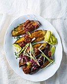 Roasted aubergines with harissa and guacamole