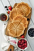 Vegan, gluten-free waffles with fresh berries and honey