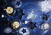 A milkshake with ground vanilla pods and the ice cream surrounded by star decorations