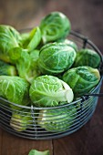 Fresh brussels sprouts in a wire basket