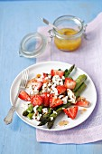 Grilled asparagus and strawberry salad with feta cheese and orange glaze