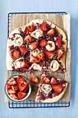 Pizza with caramelized onions, goat s cheese and strawberries