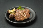 Knuckle of veal with artichokes