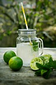 Homemade limeade in a screwtop jar on a table outside
