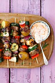 Pork kebabs with vegetables (potatoes, courgette, mushrooms, peppers and red onions)