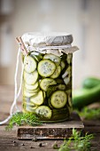 A jar of sweet pickled cucumber slices