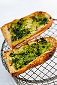 Grilled baguette slices with wild garlic pesto (close-up)