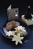 Gluten-free Christmas biscuits with a paper Christmas tree and a home-made card