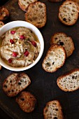 An aubergine dip with pomegranate seeds and grilled bread