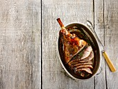 Roasted leg of lamb with ginger, honey, cider and rosemary