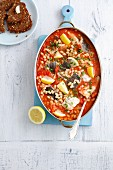 Braised cod with tomatoes, lemon and pearl beans