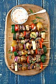 Pork and vegetable kebabs with a spicy dipping sauce
