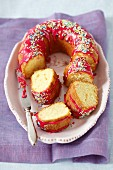 Vanilla cake with beetroot glaze and sugar sprinkles