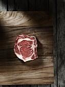 A raw, marbled rib-eye steak