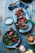 Grilled steak with spices and side dishes (Mexico)