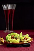 Lettuce leaves filled with ostrich tartare and date and lemon chutney