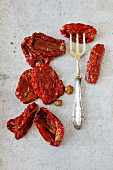 Dried tomatoes with capers in olive oil