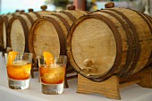Old Fashioned cocktails with whiskey from barrels