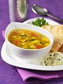 Spicy vegetables and coconut soup with chutney and dosa (India)