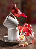 Cups and red bird ornaments decorated with ribbon