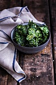 Kale chips with salt in a bowl