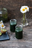 Green smoothies made with chlorella, spirulina, kiwi, lime and parsley