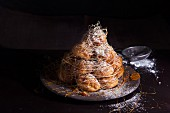 A croquembouche with icing sugar