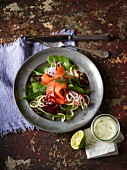 Salad with vegetable spirals, spinach and smoked salmon