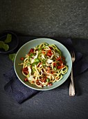 Spicy courgette and parsnip spaghetti with tomatoes and Parmesan cheese
