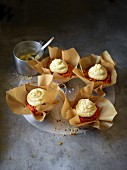 Carrot spiral muffins with almonds and cream cheese frosting