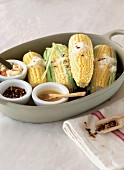 Corn cobs with chilli, salt, butter and Parmesan cheese