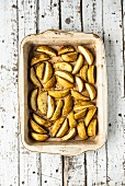 Potato wedges in a roasting dish