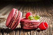 Raspberry macaroons on a wooden table