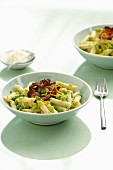 Penne pasta with pea pesto and bacon