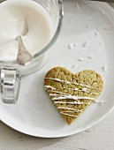 Heart-shaped cookies with matcha powder decorated with white chocolate