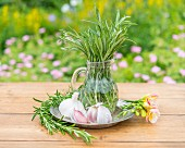 Rosemary and garlic on a garden table