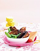 Sticky ribs with pea pods and corn on the cob