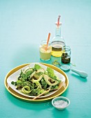 Green salad with courgettes, avocado, capers and a mustard vinaigrette