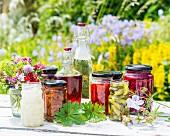 Jars of preserved vegetables with vinegar and oil