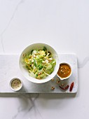 Cabbage salad with cucumber and a peanut sauce (Asia)