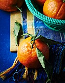 Oranges with stalks and leaves