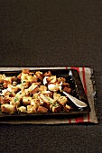 Croutons with garlic and herbs on a baking tray