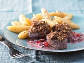 Wild boar fillet with a walnut crust and pomegranate sauce