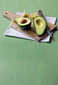 Sliced avocado on a wooden board