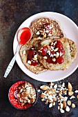Flourless banana and couscous pancakes with strawberry jam and almonds